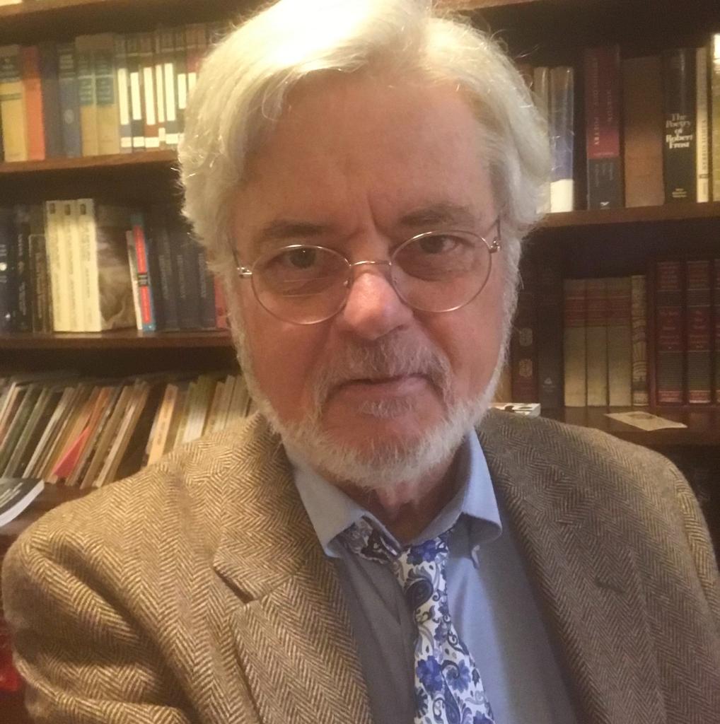 Robin Cravey in front of bookshelves